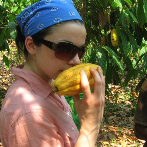 Ginger Smelling a Cacao Pod