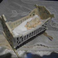 white chocolate cradle with sleeping baby
