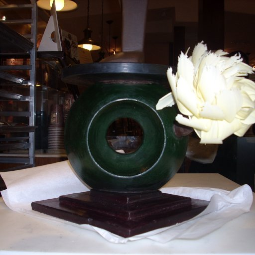 Showpiece base and flower